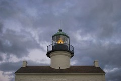 The light above.... (Joe Hengel) Tags: california ca roof light sunset lighthouse clouds sandiego solstice socal wintersolstice lit southerncalifornia roofline pointloma sandiegocounty pointlomalighthouse winterstormclouds