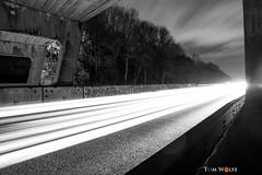 Head into the light... (trwolfe13) Tags: road longexposure bridge light urban blackandwhite cars monochrome lines metal night compo
