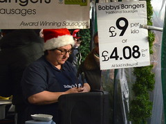 Buying bangers at Christmas in Manchester (Tony Worrall) Tags: county christmas xmas city uk decorations england food man sign price night festive season manchester fun lights nice stream tour open place northwest unitedkingdom candid country seasonal north stall visit location eat area but lit merry sell northern update bangers attraction manc gmr welovethenorth 2015tonyworrall