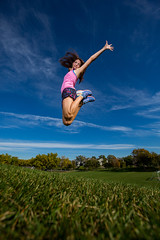 Wide open space (Flickr_Rick) Tags: outside autumn athletic woman brunette jump jumping jumpology