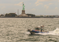 """Color of Autumn 2016 In NYC (NYC and Americas Expression Of Liberty and Freedom For All"""" (nrhodesphotos(the_eye_of_the_moment)) Tags: dsc0080172 autumn season america usa colorofautumn2016innyc statureofliberty torch bedloesisland libertyisland nypd nypdpatrolboat nyharbor waterfront pier dock boat sculpture girl trees plantlife freedom expressionoffreedom wake stone metal flame outdoorevent nyc transportation vehicle outdoor skyline buildings americanflag"""