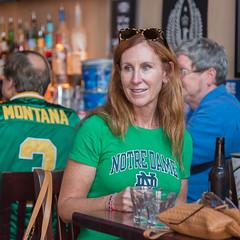 Notre Dame Fan (Ron Scubadiver's Wild Life) Tags: green redhead girl woman candid street style nikon 24120 austin texas 6th