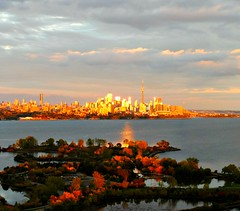 Enjoy this reflected sunlight in Toronto. (Trinimusic2008 - stay blessed) Tags: trinimusic2008 judymeikle nature today sunset light cityscape lakeontario water viewfromourcondobuilding toronto to ontario canada trees autumn fall