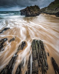 Flowing Sands (Augmented Reality Images (Getty Contributor)) Tags: beach canon clouds coastline landscape leefilters longexposure morayshire rocks sand scotland seascape sunnysidebeach water waves