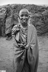 """Slim"" - Maasai - Tanzania - Africa (TLMELO) Tags: tanzania kid boy child criana menino portrait africa masai tribe tribo serengeti poor pobre angry bravo boring kilimanjaro african africano africana retrato mount kilimanjaromount friends brothers mom son baby maasai woman hat women"