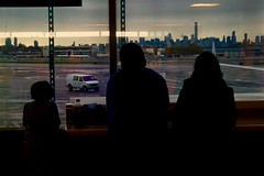 Gazing Out Toward Manhattan (spinadelic) Tags: stevespencer november 2016 fall autumn newyork ny nyc thecity urban gotham travel family silhouette watch look watching looking view gaze wait waiting flight delay van airplane plane interior window manhattan skyline skyscrapers iconic icons queens laguardia