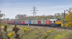 66747 4M23 Felixstowe to Hams Hall Brantham 17112016 (Waddo's World of Railways) Tags: 66 667 747 66747 rail railway loco locomotive train freight intermodal gbrf container containers box boxes dull drizzle rain cloudy overcast pylon pylons wires suffolk brantham uk england field trees autumn november 2016 class66 gbrailfreight containertrain freighttrain intermodaltrain 4m23 hams hall felixstowe 4m23felixstowetohamshall shed diesel ying gm engine driver embankment