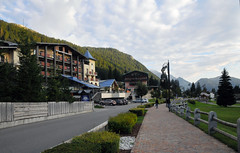 Walking back to Spinale Hotel (Vee living life to the full) Tags: italy leger travel touring holiday nikond300 landscape rock towers mountain heathaze view road sky cloud blue water morning light spinale madonnadicampiglio hotel