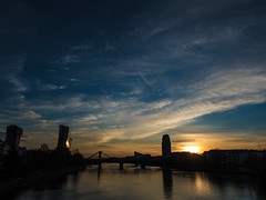 Sunrise over Frankfurt (benjaminwolf1) Tags: reflection ecb water river blue red sky clouds silhouette bridge daylight sunrise frankfurt olympus