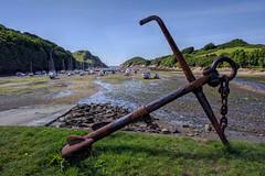Watermouth Bay, North Devon [phone camera] (Aliy) Tags: watermouth watermouthbay bay beach devon northdevon coast sand boat boats fishingboat fishingboats stream cliff cliffs anchor rusty oldanchor sea