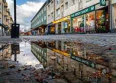 Reflections (johanbe) Tags: reflections rain puddle street cloudy sky water cobblestonestreet cobblestone butik store thebodyshop vstragatan kunglv sweden autumn hst affr